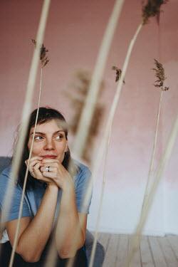 Daniil Kontorovich WOMAN SITTING INDOORS WITH DRIED GRASS Women