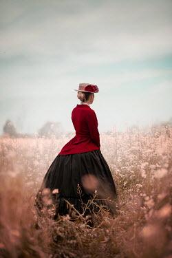 Ildiko Neer Victorian woman standing in meadow