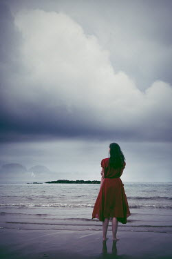 Marie Carr WOMAN ON BEACH WATCHING SEA WITH CLOUDS Women