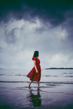 Marie Carr WOMAN WALKING ON STORMY BEACH Women