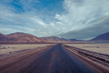 Maria Jose Rivera EMPTY DESERT ROAD WITH MOUNTAINS Roads