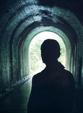 Mark Owen SILHOUETTED WOMAN STANDING IN TUNNEL Women