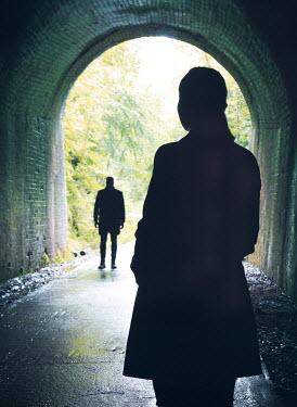 Mark Owen SILHOUETTED WOMAN WATCHING MAN IN TUNNEL Couples