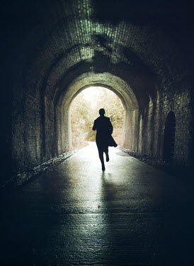 Mark Owen SILHOUETTED WOMAN RUNNING IN TUNNEL Women