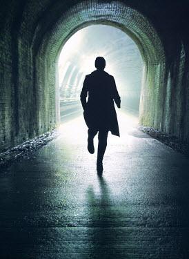 Mark Owen SILHOUETTED WOMAN RUNNING IN TUNNEL Women