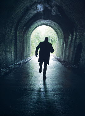 Mark Owen SILHOUETTED MAN RUNNING IN TUNNEL Men