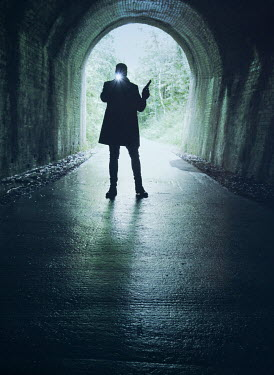 Mark Owen SILHOUETTED MAN WITH GUN AND TORCH IN TUNNEL Men