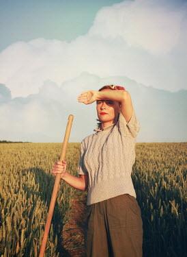 Mark Owen WOMAN SHIELDING EYES FORM SUN IN WHEAT FIELD Women