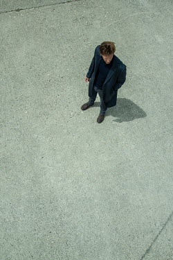 CollaborationJS An arial view of a man standing  on a stone surface