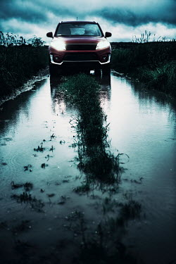Magdalena Russocka MODERN CAR ON FLOODED COUNTRY ROAD Cars