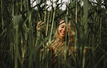 Daniil Kontorovich HAPPY BLONDE WOMAN IN BAMBOO BUSHES Women
