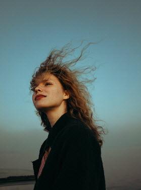 Daniil Kontorovich GIRL WITH HAIR BLOWING IN WIND IN COUNTRYSIDE Women