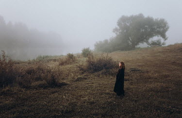 Daniil Kontorovich WOMAN STANDING IN FOGGY LANDSCAPE WITH RIVER Women