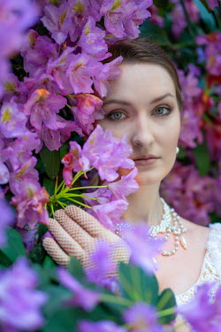 Jaroslaw Blaminsky WOMAN WITH PEARL NECKLACE WITH  PINK FLOWERS Women