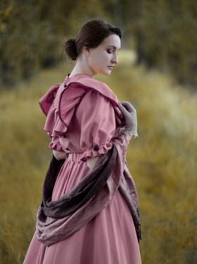 Jaroslaw Blaminsky WOMAN IN PINK DRESS IN STANDING COUNTRYSIDE Women