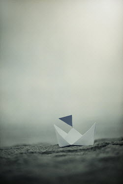 Jaime Brandel PAPER BOAT WITH FLAG ON BEACH Miscellaneous Objects