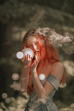 Jovana Rikalo WOMAN WITH RED HAIR HOLDING CRYSTAL BALL WITH SMOKE Women