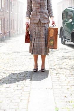 Lee Avison anonymous 1940s woman holding vintage luggage
