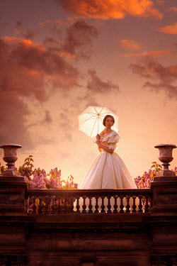 Lee Avison victorian woman with parasol at sunset