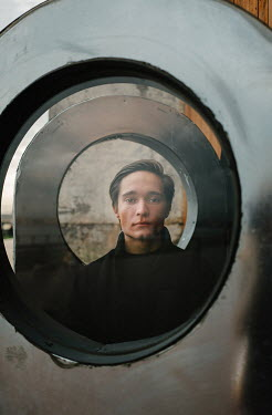 Daniil Kontorovich MAN STARING THROUGH METAL CIRCLE OUTSIDE Men