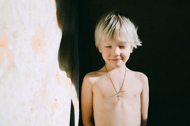 Daniil Kontorovich LITTLE BLONDE BOY WEARING CRUCIFIX IN SUNLIGHT Children