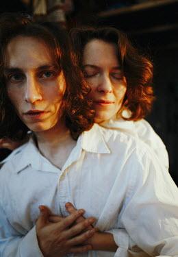 Daniil Kontorovich DREAMY WOMAN HUGGING MAN WITH RED HAIR Couples