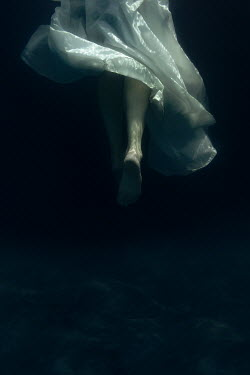 Eva Van Oosten LEGS OF WOMAN IN WHITE DRESS UNDERWATER Women