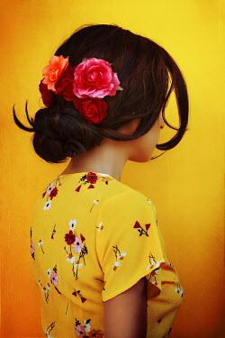 Irene Lamprakou WOMAN IN FLORAL DRESS WITH FLOWERS IN HAIR Women