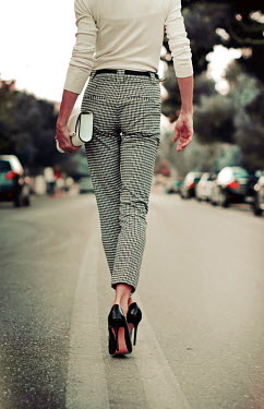 Irene Lamprakou WOMAN IN STILETTOS WALKING IN STREET Women
