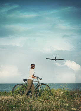 Mark Owen GIRL WITH BICYCLE BY OCEAN WATCHING WARPLANE Women