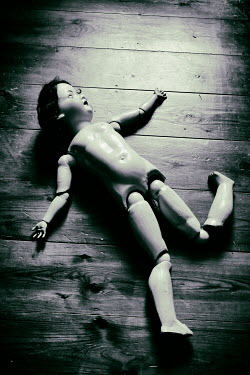 Tim Robinson NAKED ANTIQUE DOLL LYING ON FLOOR Miscellaneous Objects