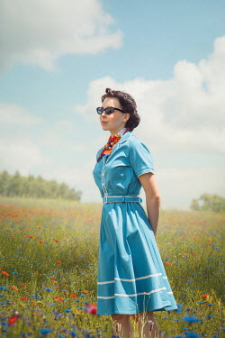 Joanna Czogala WOMAN IN SUNGLASSES STANDING IN SUMMERY MEADOW Women