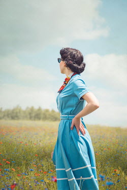 Joanna Czogala RETRO WOMAN STANDING IN SUMMERY MEADOW Women