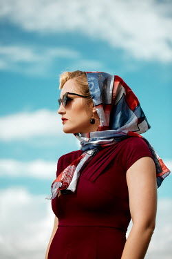 Rekha Garton RETRO WOMAN WITH HEADSCARF AND SUNGLASSES OUTDOORS Women