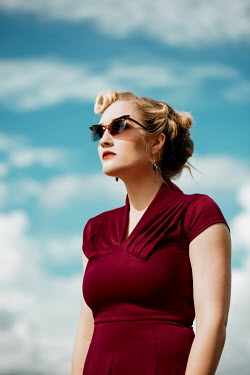 Rekha Garton RETRO WOMAN WITH SUNGLASSES OUTDOORS Women