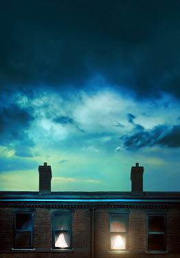Sandra Cunningham LIGHTS IN TERRACED HOUSES WITH STORMY SKY Houses