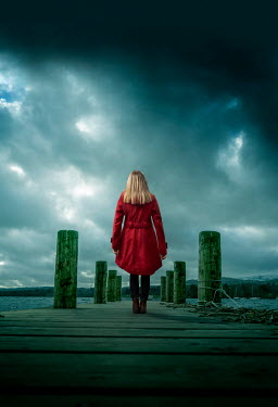 Stephen Mulcahey BLONDE WOMAN ON JETTY WATCHING STORMY LAKE Women