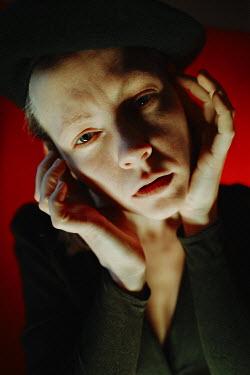 Daniil Kontorovich SAD WOMAN IN BERET TOUCHING FACE Women