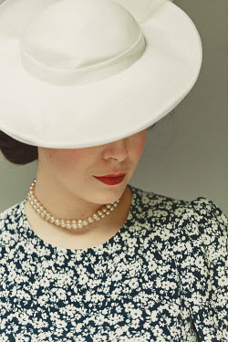 Shelley Richmond WOMAN IN HAT FLORAL DRESS AND PEARLS Women