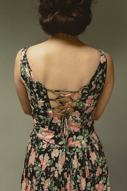 Shelley Richmond WOMAN IN FLORAL DRESS WITH LACED BACK Women