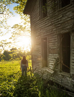 Terry Bidgood GIRL STANDING BY DERELICT COUNTRY HOUSE IN SUMMER Women