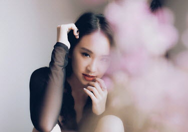 Jessica Lia ASIAN GIRL SITTING WITH PINK FLOWERS INDOORS Women