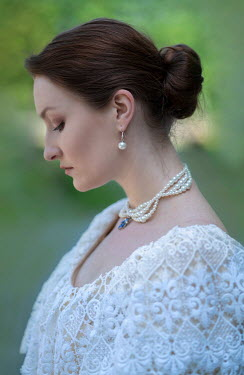 Jaroslaw Blaminsky BRUNETTE WOMAN IN WHITE LACE AND PEARLS OUTDOORS Women