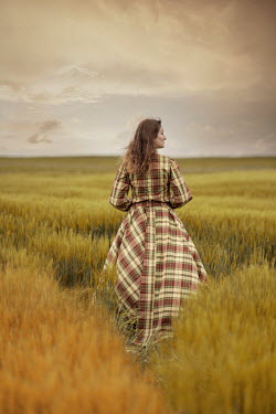 Jaroslaw Blaminsky WOMAN IN TARTAN GOWN STANDING IN COUNTRYSIDE Women