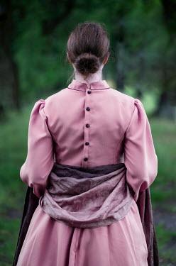 Jaroslaw Blaminsky HISTORICAL WOMAN WITH SHAWL STANDING IN COUNTRYSIDE Women