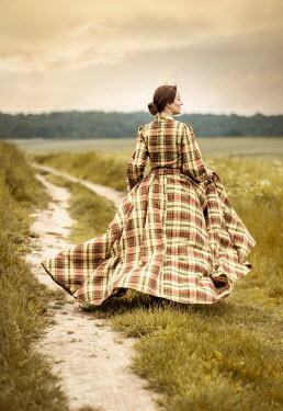 Jaroslaw Blaminsky WOMAN IN TARTAN GOWN ON COUNTRYSIDE PATH Women
