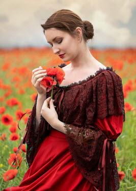 Jaroslaw Blaminsky WOMAN IN RED LACE DRESS IN POPPY FIELD Women