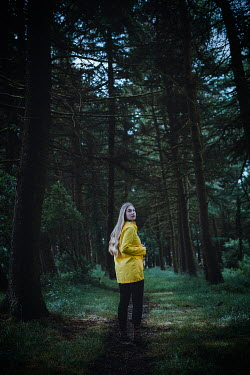 Shelley Richmond BLONDE WOMAN IN YELLOW JACKET IN FOREST Women