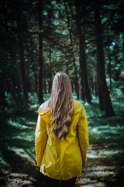 Shelley Richmond BLONDE WOMAN IN YELLOW JACKET ON FOREST PATH Women