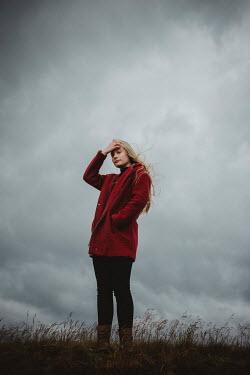 Shelley Richmond BLONDE WOMAN STANDING IN WINTRY COUNTRYSIDE Women